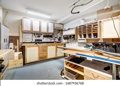 Garage workshop for cabinet making and wood working with tools and equipment