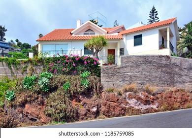 GARAJAU, MADEIRA, PORTUGAL - AUGUST 31, 2018: Modern house  built into the hillside in the upmarket area of Garajau