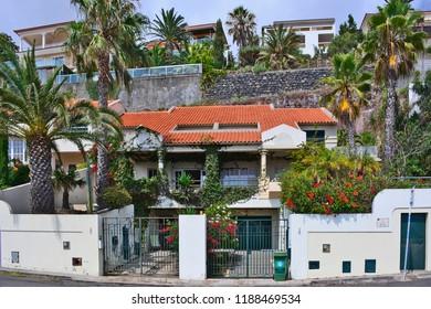 GARAJAU, MADEIRA, PORTUGAL - AUGUST 31, 2018: Luxury villas built into the hillside in the upmarket area.