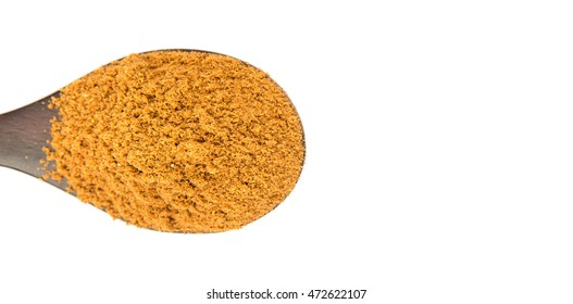 Garam masala or mix spices blend in wooden spoon over white background