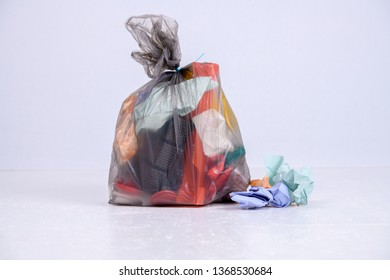 garbage bag with defferent content  in front of light background