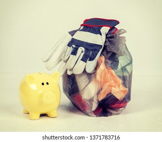 garbage bag with defferent content with yellow piggy bank