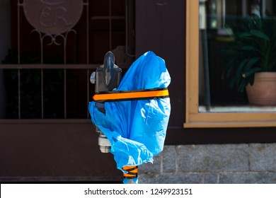 Garbage bag on a Parking meter on a construction site