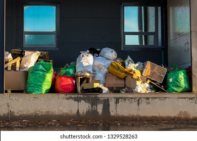 Garbage bags and boxes on the loading dock. Garbage removal