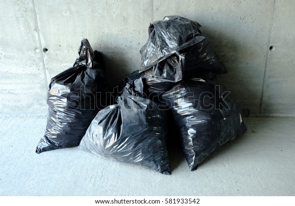 Garbage bags group on the floor.