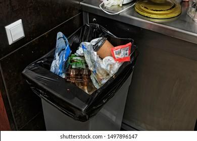 Garbage bin filled with garbage in the restaurant's kitchen
