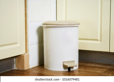 Garbage bin in the kitchen corner