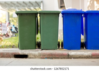 Garbage bin in public park.colorful trash bin.wheelie bin for rubbish,Public trash background,Big pile of garbage and waiste in black bags.