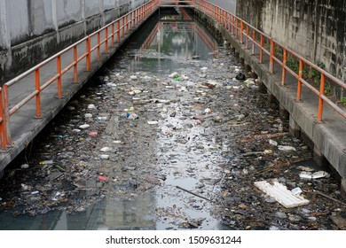 Garbage and bottles floating on water.Plastic Contamination into Nature.People illegally thrown garbage into water.Dirty environment polluting trash in thailand