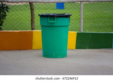Garbage can with colorful background