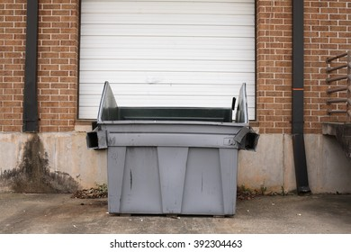 Garbage Can in Front of Warehouse Door