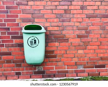 Garbage Can hanging on a wall