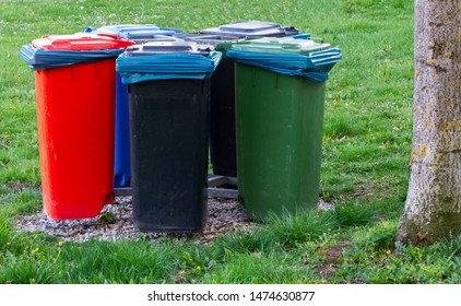 Garbage cans for waste separation and recycling in a park