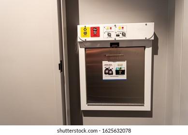 garbage chute door in apartment building