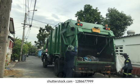 Garbage collector worker at garbage truck or Waste truck, move for sorting out, eliminate, or landfill, Bangkok, Thailand, 2019.
