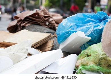 Garbage container on street with blue sack