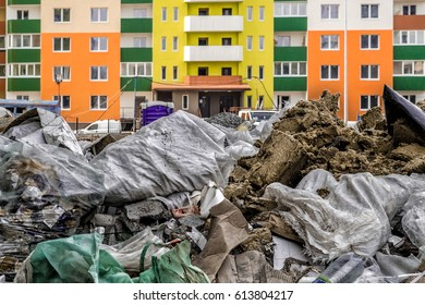 Garbage dump in bags against the background of a new house