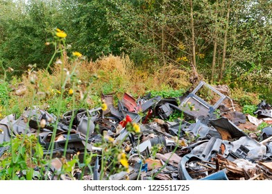 garbage dump in the forest, human pollution
