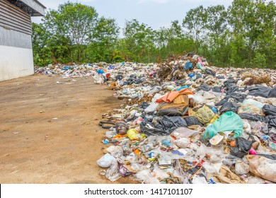 garbage dump pile in trash dump or landfill,truck is dumping the gabage from municipal,pollution concept