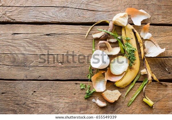Garbage and food waste on a wooden background