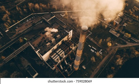 Garbage incineration plant. Waste incinerator plant with smoking smokestack. The problem of environmental pollution by factories.