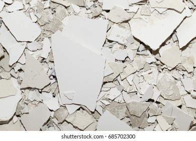 garbage left after construction and repair. Photo of a close-up of old plaster and putty