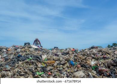 Garbage man on garbage dump