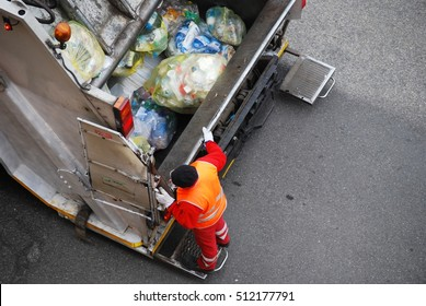 Garbage man at work on the truck