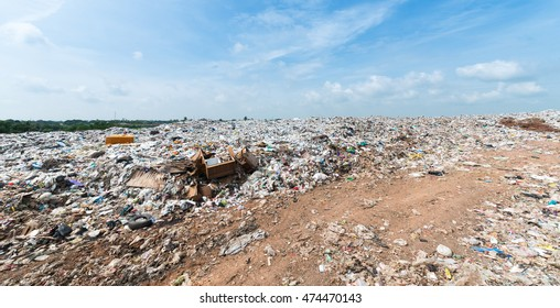 garbage in Municipal landfill for household waste with white cloud and blue sky, polution problem, selective focus