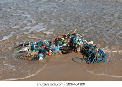 garbage on the beach after the storm in Spain, closeup