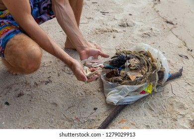 Garbage on the beach makes the beach unattractive. Dirty and waste water