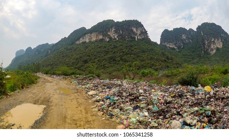 Garbage in paradise.... Illegal dumping ground on the edge of national park in Trang An Vietnam
