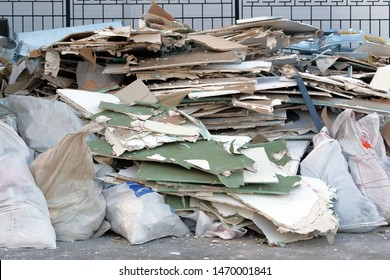 Garbage pile, ecology contamination with plastic and construction garbage. Removal of debris. Trash heap.