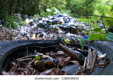 Garbage pile in trash dump or landfill in jungle of Guatemala. Pollution concept.