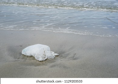 Garbage plastic bag On the beach