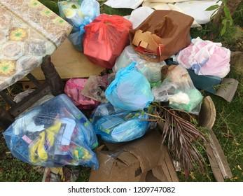 Garbage in plastic bags littering the street