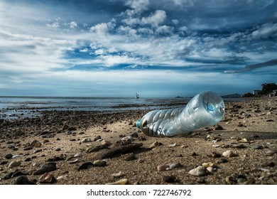 Garbage plastic water bottle on the beach, saving earth concept