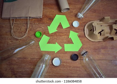 garbage and recycle symbol on wood background for concept recycling and reuse style vintage