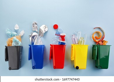 Garbage recycling in flat style on blue background. Garbage collection.