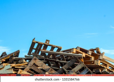 garbage removal. old wooden pallets for recycling