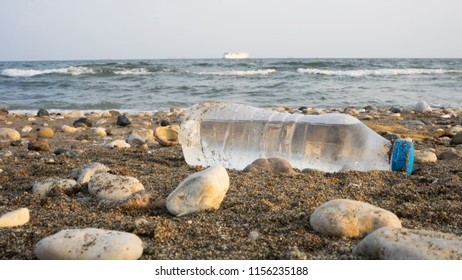 Garbage from ships. Empty used dirty plastic bottle. Environmental pollution. Ecological problem. water wastage. ship backplane.