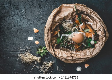 Garbage sorting. Organic food waste from vegetable ready for recycling and to compost on the dark backgrond. Environmentally responsible behavior, ecology concept. Flat lay