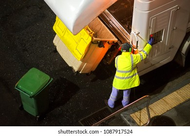 garbage truck and dustman working