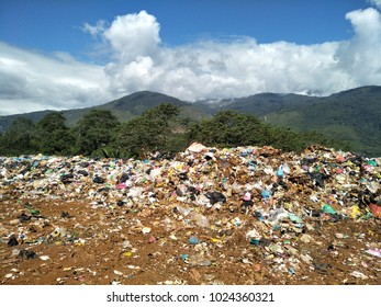 Garbages,mountain and blue sky.