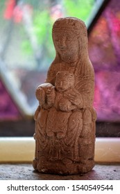 Garbagna, Alessandria- Italy- October 12 2019: religious statuette depicting the Madonna and Child on a colored and shaded background