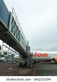 Garbarata or Tangga Belalai or airplane bridge at Sultan Hasanudin Airport to Lion air. Makasar, indonesia. 16/08/2017.