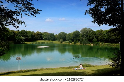 GARCHING, GERMANY - JULY 29, 2018 - Summer hot weather in Bavaria, panoramic view of  Garchinger See, small lake near Munich, ideal for relax and bath.