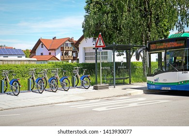 GARCHING, GERMANY - JUNE 2, 2019 eletric bikes ready to rent conveniently lined up on the sidewalk near the bus stop.