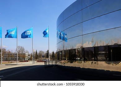 GARCHING, GERMANY - MARCH 24,2018 - Campus of Technical University of Munich (TUM). Informatics department, facade with TUM flags