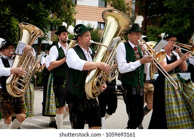 GARCHING, GERMANY-JULY 2, 2017. Brass band musicians in Bavarian costume perform a traditional parade in Garching university town near Munich